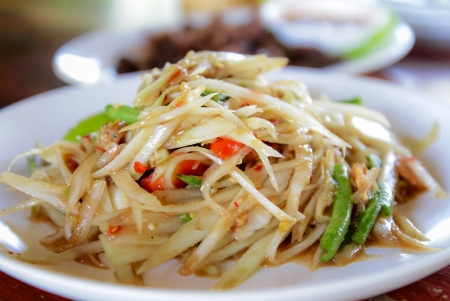 Thai papaya salad,on white plate,Thai food
