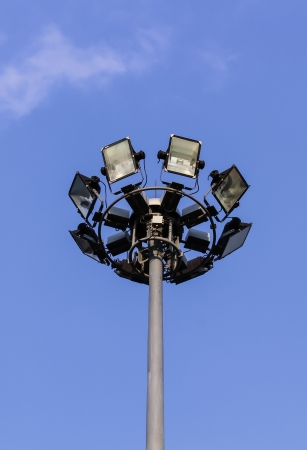 Spotlight or floodlight tower in blue sky