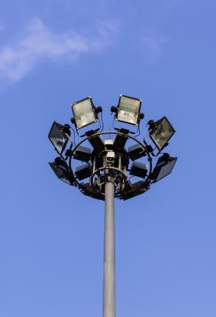 spaceport: Spotlight or floodlight tower in blue sky