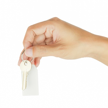 House key in hand isolated on white background