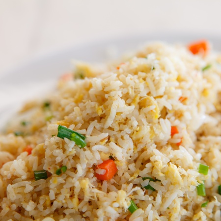 crab fried rice with egg on a white plate
