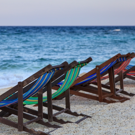 beach chairs on white sand in Thailand Stock Photo