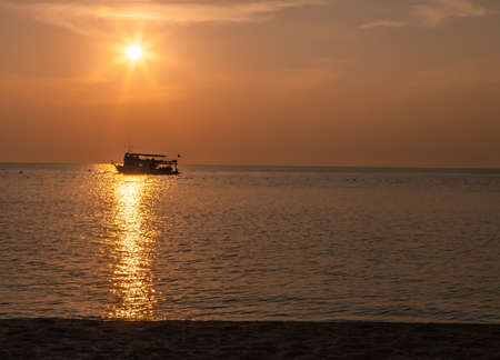 boat silhouette, sunset,in the sea, Thailand