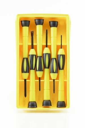 Screwdriver in the yellow package, isolated on white background
