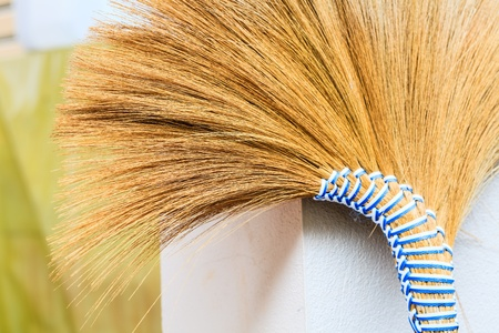 Old broom,used ready for cleaning,Thailand Stock Photo