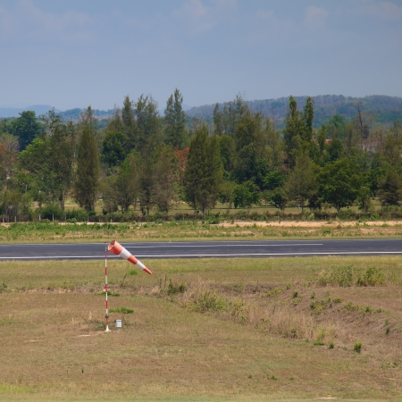 orange-white stripe wind sock in the airport