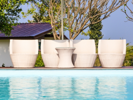 swimming pool white chairs and the table Stock Photo