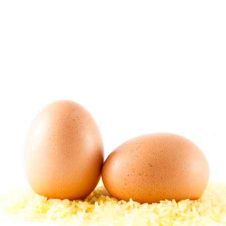 chicken eggs on yellow rice Stock Photo
