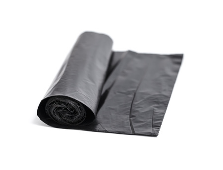 Roll of black trash bags isolated on white  photo