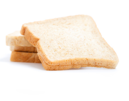 Sliced wholewheat bread isolated on white background
