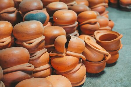 Pile of Orange earthenware pot. Thailand art made by hand.