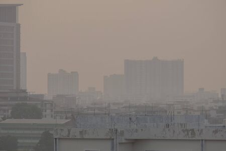 Air pollution from Lots of dust or PM2.5 particle exceeds the standard (AQI) at Bangkok, Thailand. Negative effect on Respiratory system and health.