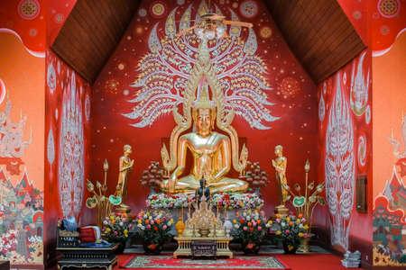 Phitsanulok, Thailand - August 18 2020: Gold buddha statue at Chapel in the pool at Wat si khom kham, Phayao, Thailand . Beautiful of historic city at Buddhism temple.