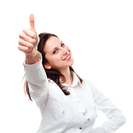 Portrait of an excited young woman gesturing a thumbs up sign against white background photo