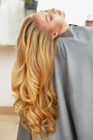 Long Blonde Hair Woman in hair salon Stock Photo