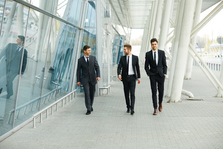 business life: Business People Walking in the street Stock Photo