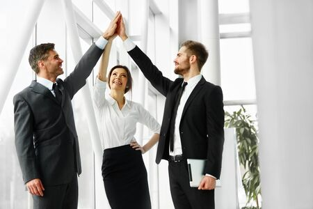 five people: Successful Business People Celebrating a Deal