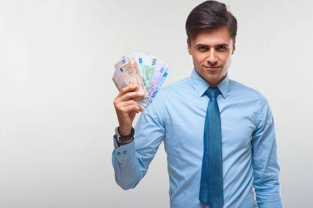 Businessman holding money Stock Photo