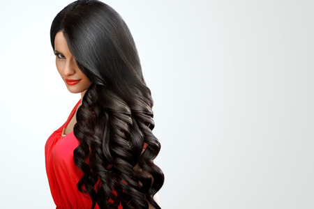 Portrait of Beautiful Woman with Black Wavy Hair