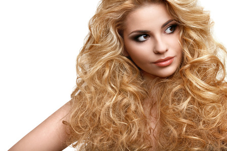 hair style: Portrait of Beautiful Woman with Long Curly Hair Stock Photo