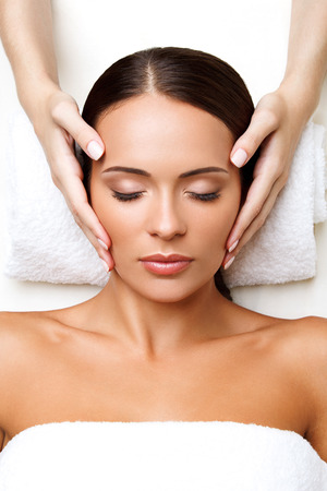 facial cleansing: Close-up of a Young Woman Getting Spa Treatment.