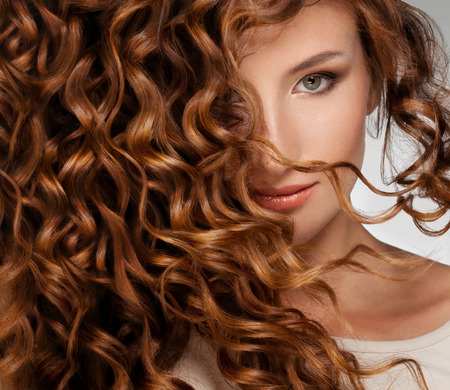 brown hair: Beautiful young woman with long curly hairs
