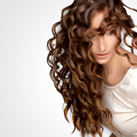 long red hair woman: Beautiful Woman with Curly Long Hair