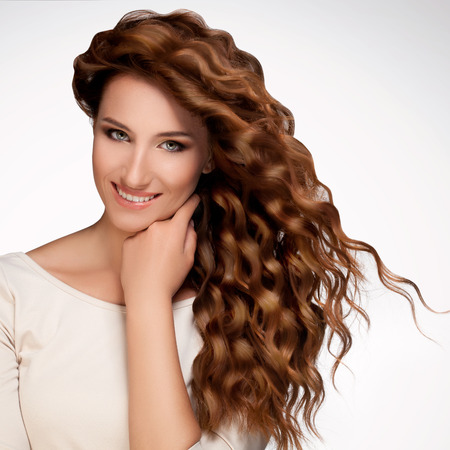 curly hair: Beautiful Woman with Curly Long Hair.