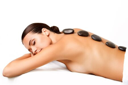 hot stones: Beautiful Woman Getting Spa Hot Stones Massage in Spa Salon.