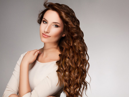eye red: Beautiful Woman with Curly Long Hair
