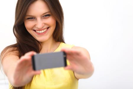 camera phone: Beautiful girl taken taking selfie self-portrait with camera phone