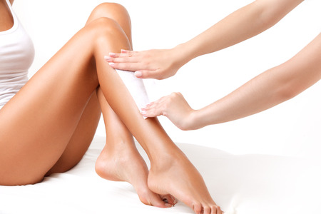 waxing: Well-groomed Woman Legs After Depilation Isolated on White Background