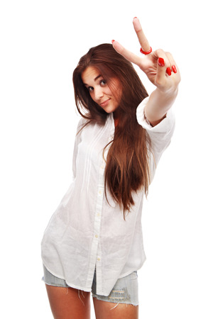 Portrait of beautiful woman showing victory sign on white background
