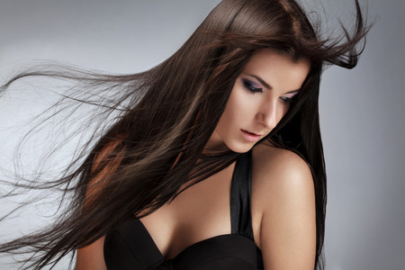 styling: Beautiful Woman with Healthy Long Hair.