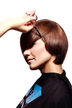 haircutting: hairdresser cuts hair