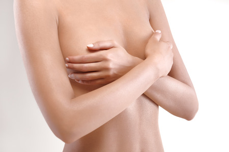breast examination: woman checking breast for signs of cancer