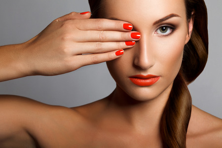 lipgloss: Beautiful Woman With Red Nails
