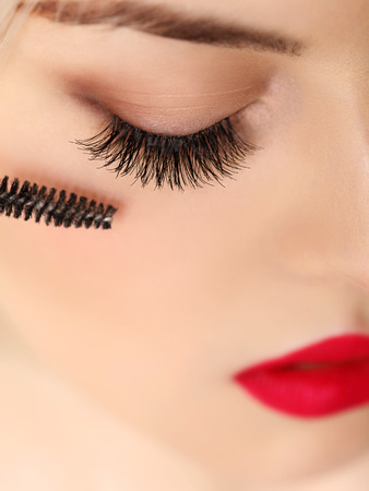 Woman eye with beautiful makeup and long eyelashes photo