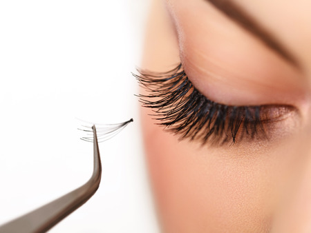 extension: Woman eye with long eyelashes on Eyelash extension Stock Photo