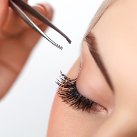 extension: Woman eye with long eyelashes. Eyelash extension. Eyebrow