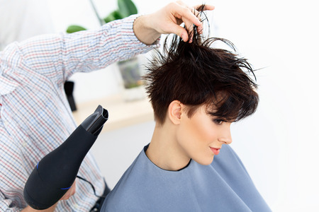 Hairdresser Using Dryer On Woman Wet Hair In Salon Short Hair