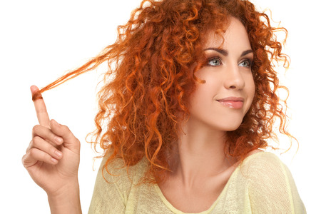Red Hair. Beautiful Woman with Curly Hair. High quality image.