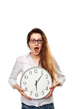 shoked: Portrait of a Shoked Young woman holding a clock in hand on white background
