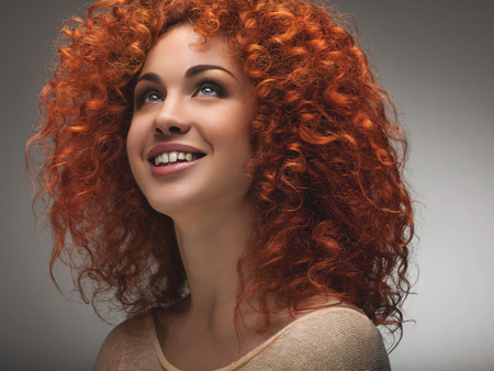 long red hair woman: Red Hair. Beautiful Woman with Curly Long Hair. High quality image.