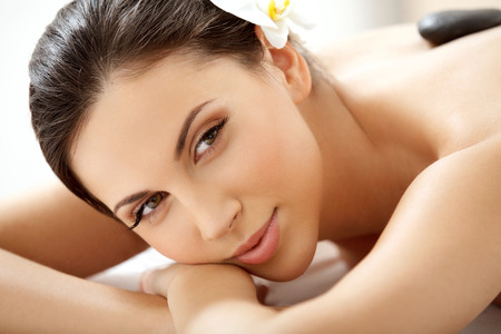 Spa Woman. Close-up of a Beautiful Woman Getting Spa Treatment in Spa Salon photo