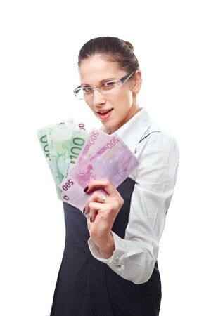 woman holding money: Portrait of excited young woman holding money in the hand on white background Stock Photo