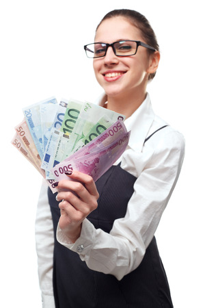 woman holding money: Portrait of cheerful business woman holding money isolated on white background Stock Photo