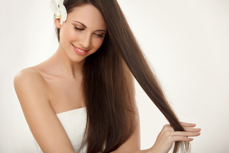young  brunette: Brown Hair. Beautiful Brunette with Long Hair. Haircare. Spa Beauty Model