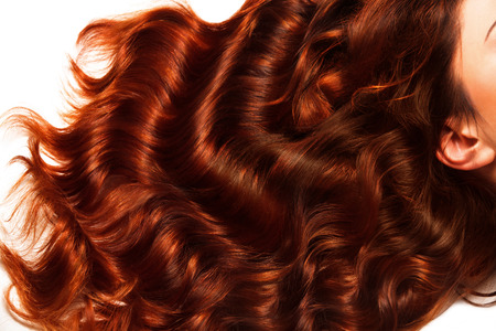 Texture des cheveux bruns bouclés. Image de haute qualité. Banque d'images