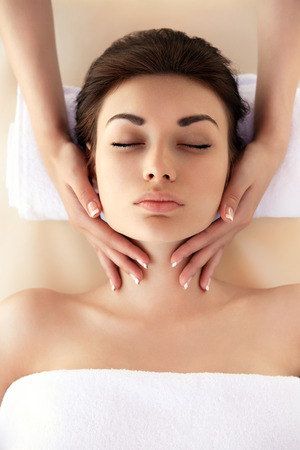 female therapist: Spa Woman. Close-up of a young woman getting spa treatment. Face Massage Stock Photo